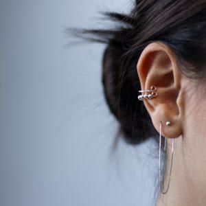 Both ears piercing